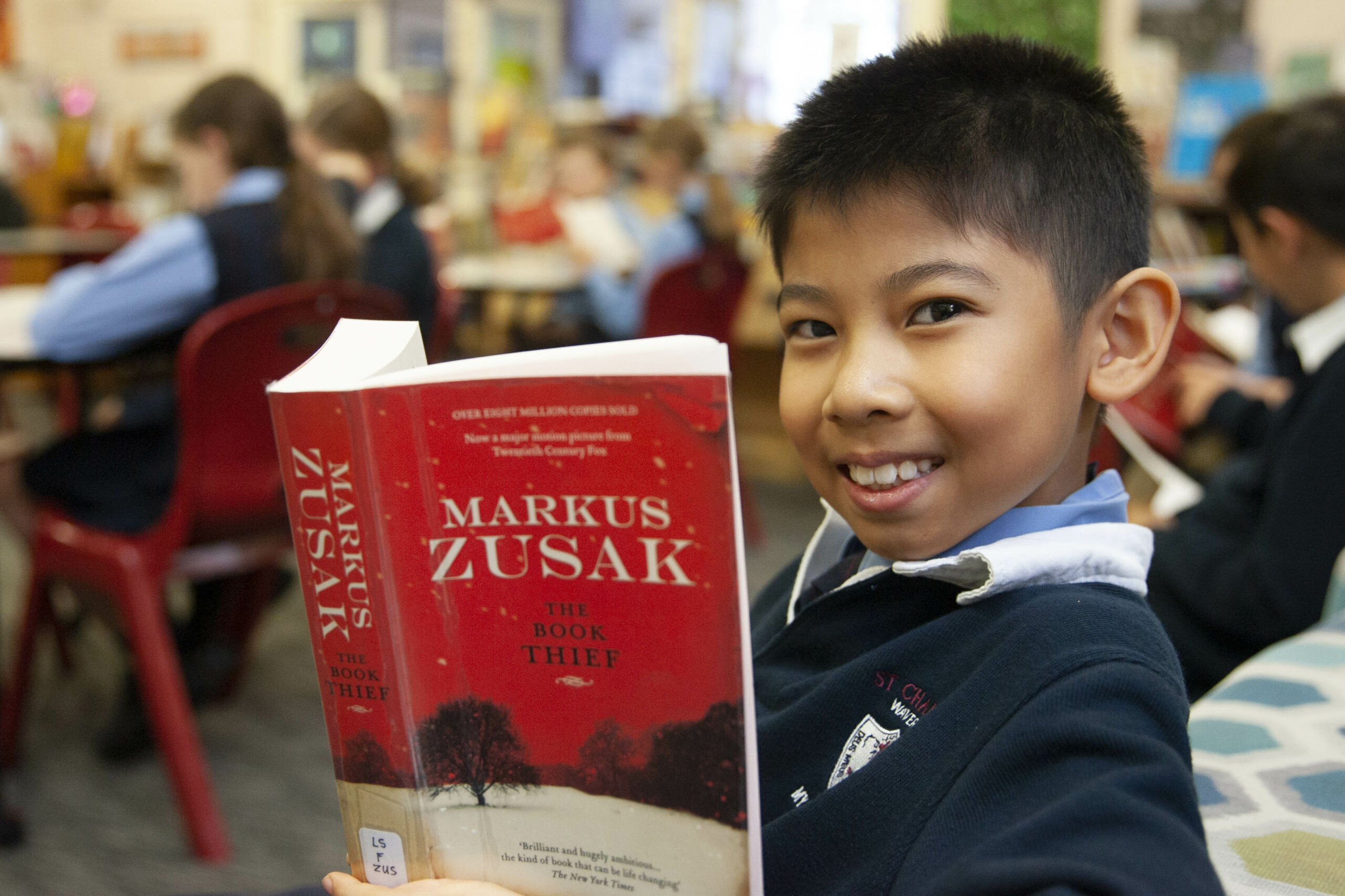 A boy from St Charles' literature enrichment group reads 'The Book Thief'